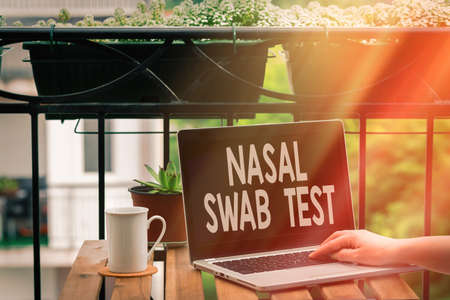 Handwriting text writing Nasal Swab Test. Conceptual photo diagnosing an upper respiratory tract infection through nasal secretion Personal workplace overview with laptop device used for individual interest