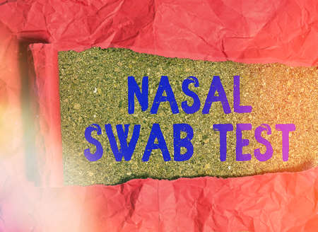Conceptual hand writing showing Nasal Swab Test. Concept meaning diagnosing an upper respiratory tract infection through nasal secretion Rolled ripped torn cardboard above a wooden classic table