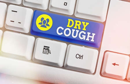 Text sign showing Dry Cough. Business photo text cough that are not accompanied by phlegm production or mucus White pc keyboard with empty note paper above white key copy space