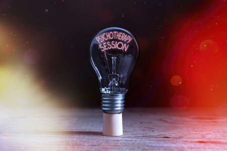 Handwriting text writing Psychotherapy Session. Conceptual photo series of meetings in treating mental health problems Realistic colored vintage light bulbs, idea sign solution thinking concept
