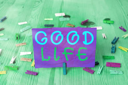 Handwriting text writing Good Life. Conceptual photo living in comfort and luxury with few problems or worries Colored crumpled rectangle shaped reminder paper light blue background