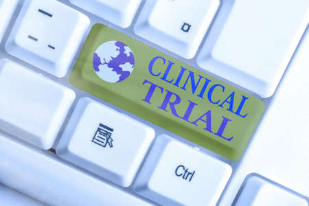 Word writing text Clinical Trial. Business photo showcasing evaluate the effectiveness and safety of medications White pc keyboard with empty note paper above white key copy space Stok Fotoğraf