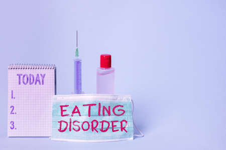 Text sign showing Eating Disorder. Business photo showcasing illnesses or severe disturbances in their eating behaviors Set of medical equipment with notepad for health condition assessment