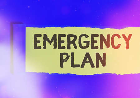 Text sign showing Emergency Plan. Business photo text instructions that outlines what workers should do in danger Rolled ripped torn cardboard placed above a wooden classic table backdrop 스톡 콘텐츠
