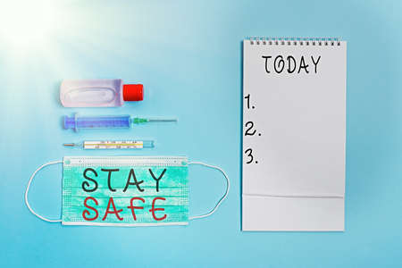 Conceptual hand writing showing Stay Safe. Concept meaning secure from threat of danger, harm or place to keep articles Set of medical equipment with notepad for health assessment Stock Photo