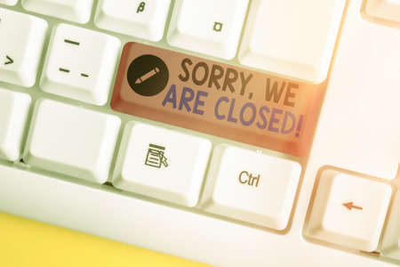 Writing note showing Sorry, We Are Closed. Business concept for apologize for shutting off business for specific time White pc keyboard with empty note paper above white key copy space 版權商用圖片