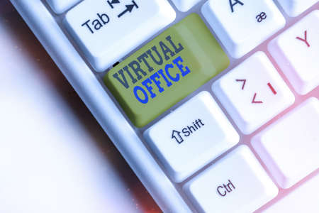 Text sign showing Virtual Office. Business photo showcasing operational domain of any business or organization virtually White pc keyboard with empty note paper above white key copy space Banco de Imagens