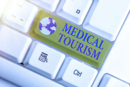 Word writing text Medical Tourism. Business photo showcasing traveling to another country seeking for medical care White pc keyboard with empty note paper above white key copy space Stock Photo