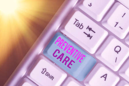 Text sign showing Preventive Care. Business photo showcasing the care you receive to prevent illnesses or diseases White pc keyboard with empty note paper above white key copy space