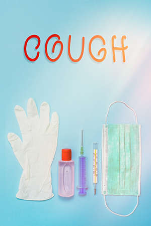 Writing note showing Cough. Business concept for sudden expulsion of air throughout the passages to clear airways Primary medical precautionary equipments for health care protection Stok Fotoğraf