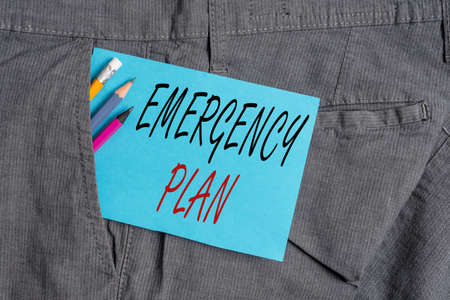 Handwriting text Emergency Plan. Conceptual photo instructions that outlines what workers should do in danger Writing equipment and blue note paper inside pocket of man work trousers