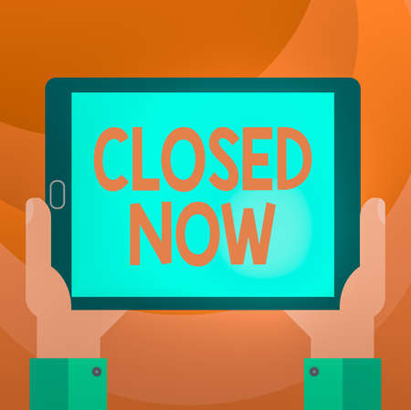 Text sign showing Closed Now. Business photo showcasing of a business having ceased trading especially for a short period Hu analysis Hand Holding Blank Screen Tablet Smartphone Display Unit photo