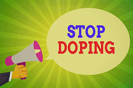 Handwriting text writing Stop Doping. Conceptual photo quit the use of banned athletic performanceenhancing drugs Hu analysis Hand Holding Megaphone and Blank Oval Speech Bubble over Sunburst 写真素材