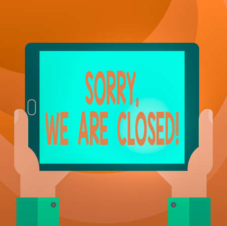Text sign showing Sorry, We Are Closed. Business photo showcasing apologize for shutting off business for specific time Hu analysis Hand Holding Blank Screen Tablet Smartphone Display Unit photo