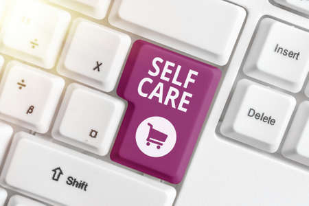 Text sign showing Self Care. Business photo showcasing the practice of taking action to preserve or improve one s is health Different colored keyboard key with accessories arranged on empty copy space