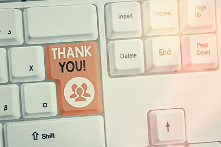 Text sign showing Thank You. Business photo text polite expression to acknowledge a gift, service or compliment Different colored keyboard key with accessories arranged on empty copy space 免版税图像