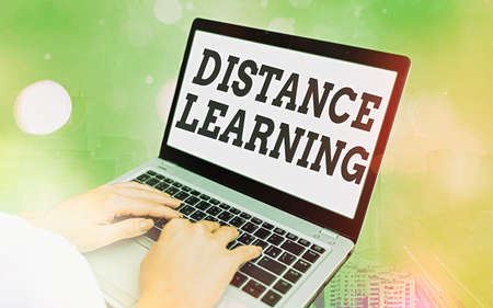 Word writing text Distance Learning. Business photo showcasing educational lectures broadcasted over the Internet remotely Modern gadgets with white display screen under colorful bokeh background Banco de Imagens