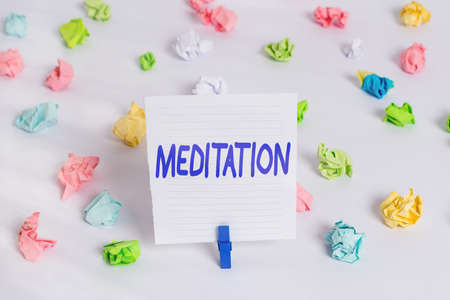 Word writing text Meditation. Business photo showcasing achieve a mentally clear and emotionally calm and stable state Colored crumpled papers empty reminder white floor background clothespin 版權商用圖片