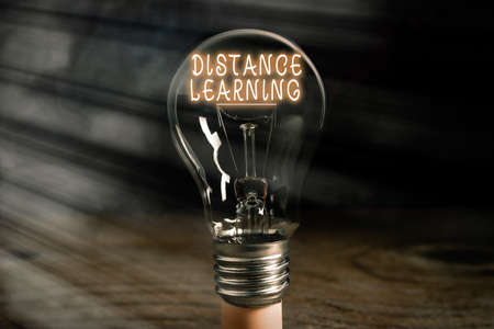 Conceptual hand writing showing Distance Learning. Concept meaning educational lectures broadcasted over the Internet remotely Realistic colored vintage light bulbs, idea sign solution Banco de Imagens