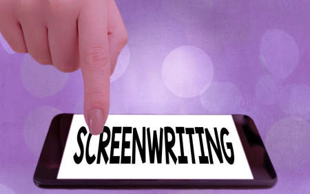 Writing note showing Screenwriting. Business concept for the art and craft of writing scripts for media communication Modern gadgets white screen under colorful bokeh background Stok Fotoğraf