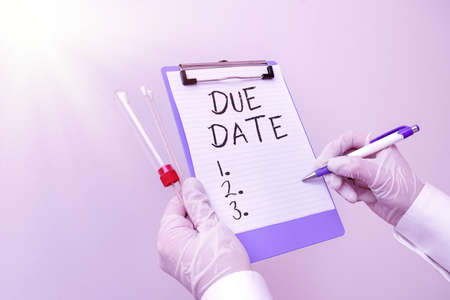 Handwriting text Due Date. Conceptual photo the day or date by which something is supposed to be done or paid Laboratory blood test sample shown for medical diagnostic analysis result Imagens