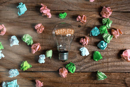 Conceptual hand writing showing Droplets. Concept meaning very small drop of a liquid can be found in certain wet places Realistic colored vintage light bulbs, idea sign solution
