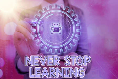 Writing note showing Never Stop Learning. Business concept for continuous education and techniques to be competitive Graphics padlock for web data information security application system