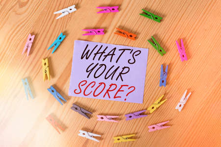 Handwriting text What S Your Score Question. Conceptual photo Tell Personal Individual Rating Average Results Statistics Colored clothespin papers empty reminder wooden floor background office