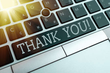 Writing note showing Thank You. Business concept for polite expression to acknowledge a gift, service or compliment Pc keyboard key with empty note paper above background copy space 版權商用圖片