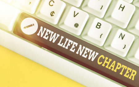 Text sign showing New Life New Chapter. Business photo text modification of brand or business Change opportunities Different colored keyboard key with accessories arranged on empty copy space