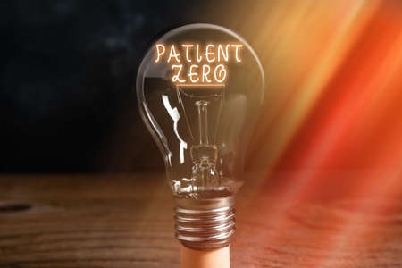 Conceptual hand writing showing Patient Zero. Concept meaning primary disease carrier of the highlycontagious disease Realistic colored vintage light bulbs, idea sign solution Imagens