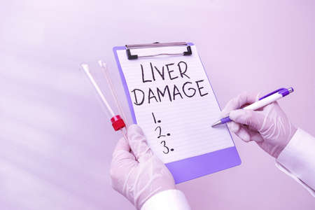Handwriting text Liver Damage. Conceptual photo any disorder of the liver Cirrhosis or scarring of the liver Laboratory blood test sample shown for medical diagnostic analysis result