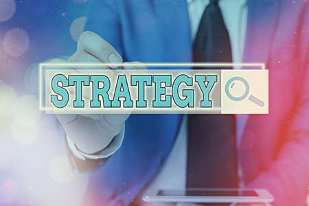 Writing note showing Strategy. Business concept for action plan or strategy designed to achieve an overall goal Web search digital information futuristic technology network connection