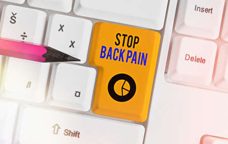 Conceptual hand writing showing Stop Back Pain. Concept meaning put an end on the pain felt in the low or upper back Colored keyboard key with accessories arranged on copy space