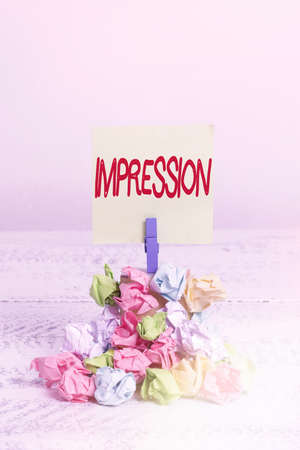 Word writing text Impression. Business photo showcasing an idea and feeling or opinion about something or someone Reminder pile colored crumpled paper clothespin reminder white wooden space Stock Photo