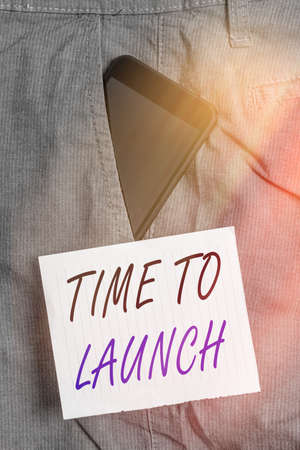 Writing note showing Time To Launch. Business concept for Business StartUp, planning and strategy, management, realization Smartphone device inside trousers front pocket note paper