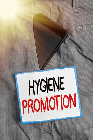 Conceptual hand writing showing Hygiene Promotion. Concept meaning systematic program to prevent related disease with sanitation Smartphone device inside trousers front pocket note paper