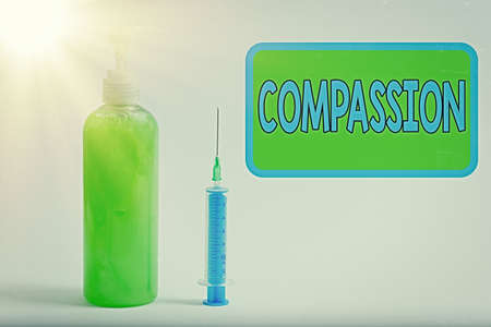 Text sign showing Compassion. Business photo text empathy and concern for the pain or misfortune of others Primary medical precautionary equipments for health care protection 版權商用圖片