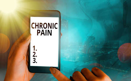 Handwriting text Chronic Pain. Conceptual photo discomfort that persists or progresses over a long period Modern gadgets with white display screen under colorful bokeh background