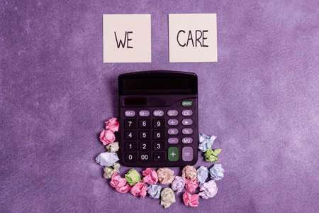 Writing note showing We Care. Business concept for Cherishing someones life Giving care and providing their needs Paper accessories with smartphone arranged on different background
