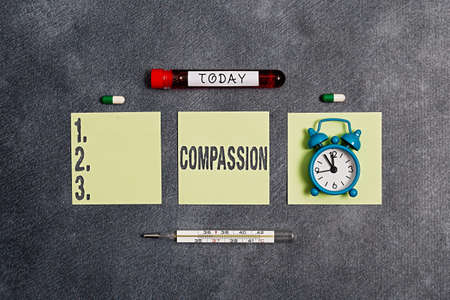 Writing note showing Compassion. Business concept for empathy and concern for the pain or misfortune of others Blood sample vial medical accessories ready for examination