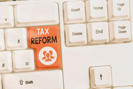 Text sign showing Tax Reform. Business photo text government policy about the collection of taxes with business owners Different colored keyboard key with accessories arranged on empty copy space