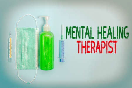 Text sign showing Mental Healing Therapist. Business photo text helping an individual express emotions in healthy ways Primary medical precautionary equipments for health care protection Archivio Fotografico