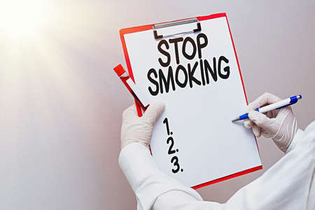 Word writing text Stop Smoking. Business photo showcasing the process of discontinuing or quitting tobacco smoking Laboratory blood test sample shown for medical diagnostic analysis result