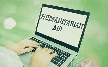 Word writing text Humanitarian Aid. Business photo showcasing immediate assistance provided after natural and manmade disaster Modern gadgets with white display screen under colorful bokeh background