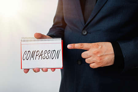 Handwriting text Compassion. Conceptual photo empathy and concern for the pain or misfortune of others Model displaying different empty color notepad mock-up for writing idea