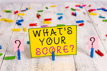 Text sign showing What S Your Score Question. Business photo text Tell Personal Individual Rating Average Results Statistics Scribbled and crumbling sheet with paper clips placed on the wooden table