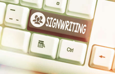 Handwriting text Signwriting. Conceptual photo any type of clear lettering intended for use on symbols Different colored keyboard key with accessories arranged on empty copy space