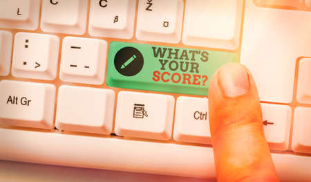 Text sign showing What S Your Score Question. Business photo text Tell Personal Individual Rating Average Results Statistics White pc keyboard with empty note paper above white key copy space