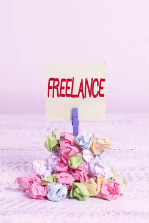 Word writing text Freelance. Business photo showcasing working at different firms rather than being permanently Reminder pile colored crumpled paper clothespin reminder white wooden space Stock fotó